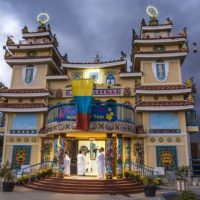 The Cao Dai Temple in Garden Grove is one of only four in the United States that is modeled after the Holy See in Tay Ninh, Vietnam. The templeÕs architecture combines Catholic, Buddhist and Hindu influences. Inside, the temple has pastel-pink columns with protruding deep-green dragon statues and a sky-blue ceiling with stars.  ///ADDITIONAL INFORMATION: 0305.ggw.centerpiece.CaoDai Ð 2/27/15 Ð LEONARD ORTIZ, ORANGE COUNTY REGISTER - _LOR8520.NEF - there is a service honoring the founder of the Cao Dai religion, which was founded in 1926 in Vietnam. The Garden Grove temple, the only one in Orange County, is one of the few in the country that is an exact replica of the Holy See in Vietnam.